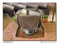 Bronze baptismal font with hand made ceramic tile pool and surround at the base, for Rejoice Lutheran Church, Omaha, NE.