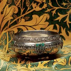 This silver and enamel rose bowl, made by Edward Spencer in 1912 for the Guild of Artificers, was pictured in the 1915 Studio Decorative Art Yearbook.