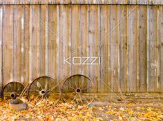 wagon wheels - Wagon wheels against a wooden wall