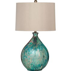This table lamp features an eye catching teardrop shaped base of blue mercury glass and is completed with an off white shade with finial. Mercury Glass Lamp, Teal Living Rooms, Blue Table Lamp, Interior House Colors, Task Lamps, Diffused Light, Lamp Sets, Drum Shade, Colorful Interiors