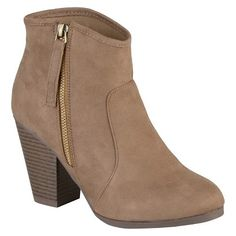 A contemporary punctuation mark to any ensemble, the Women's Journee Collection Link Faux Suede Ankle Boots are a dynamic addition to your footwear rotation. These sleek booties look fabulous paired with your favorite denim, but also make a svelte statement when worn with tights and a skirt. Featuring a stacked block heel, a velvety faux suede exterior, a slip-on design with a side zipper and a lined interior.
