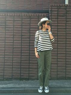 Hat, striped top, olive pants, sneakers.: