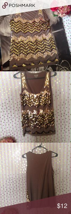 Sequined tank It's a.n.a. Brand and it has all of its sequins. The material is super soft with a grayish brown color and gold sequins. a.n.a Tops Tank Tops
