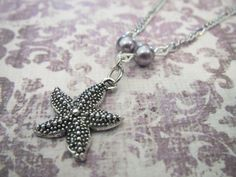 Silver Starfish necklace with light purple pearls.  Pretty jewelry that is lovely and affordable.  laurenicole