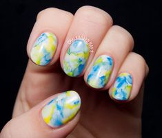 A very pretty flower inspired watercolor nail art design. Use blue, white and yellow polishes to complete the look and carefully paint on the flower details.