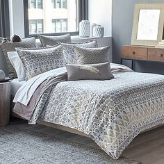Bring the beauty of the southwest into your bedroom with the unique Parker Loft Taos Reversible Duvet Cover Set. Decked out in a southwest-inspired pattern, the cool grey and taupe bedding is the perfect way to complete your desert-themed décor.