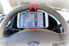 SMART STEERING WHEEL PHONE HOLDER  The SMART Solution For Using GPS On Your Phone.  STARTING AT    67% OFF
