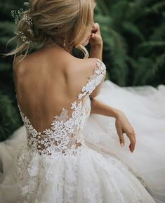 White lace low back wedding dress on blond model Honeymoon Tips, Wedding Centerpieces, Wedding Bouquets