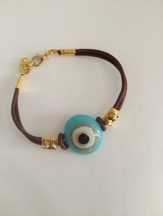 evil eye bracelet murano glass against the evil eye turquoise color glass - hand made with gold leather- -closing and chain gold plated on Etsy, 220.00 ₪