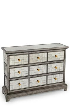 "Materials: Wood and glass Measurements: 45""w x 13.5""d x 32.5""h, 120 lbs 9 drawers. Drawer measurements: 11""w x 9.5""d x 3.5""h each"