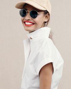 ╳   J.Crew women's solid short-sleeve popover shirt, Ray-Ban® sunglasses and woven baseball cap.