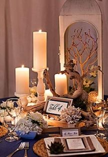 Driftwood and candles great table decor and color theme