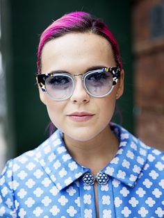 The Best Beauty Street Style From NYFW Spring 2016: Andrea Maria's hot pink hair and printed sunglasses | allure.com