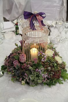 Flower Design Events: Autumn Purple Birdcage Table Design for a Wedding at The Woodland's Suite at Ribby Hall. Cage centre pieces, matching the invitations Table Arrangements, Table Centerpieces, Wedding Centerpieces, Floral Arrangements, Wedding Decorations, Wedding Ideas, Fall Wedding Flowers, Autumn Wedding, Purple Wedding