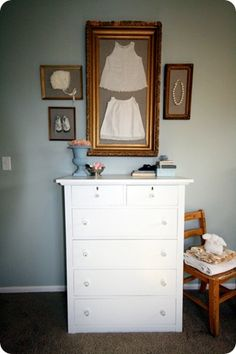 Luv the idea with the frames! I have a sweet outfit and bonnet that was mine when I was a baby that would look so sweet on baby girl's nursery walls.