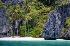 Island hopping in El Nido brings you to beautiful little beaches, such as this one.