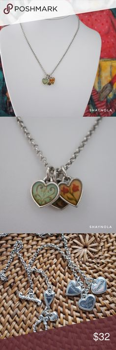 """Brighton Reversible Piccadilly Hearts Necklace A sweet necklace from an older Brighton collection called Piccadilly hearts. It has three heart pendants that reverses from colorful prints to motivational words... Passion, Gratitude, Embrace Life... and a heart near the toggle closure that says Love. Perfect for any age. It's in excellent condition. Housed the way from light and dust. Measures 9"""" (18""""). Brighton Jewelry Necklaces"""