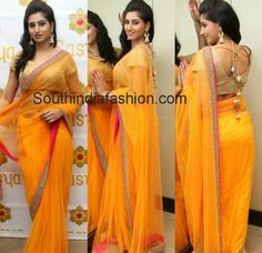Model and actress Shamili in Sasya's beautiful yellow net saree with golden pearl work border and contrast pink piping paired up with gold color blouse.