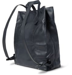 Made to the same exacting standards as the label's iconic footwear, Berluti's 'Origami' backpack combines expert craftsmanship with innovative design. This versatile piece is cut from exceptionally supple and lightweight leather, and can be folded and tucked away when not in use. Adjust this convertible style's thin shoulder straps to carry yours as a tote.