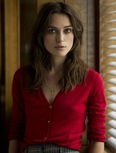 Keira Knightley striking portrait in a v-neck button up red blouse braless, star of Pirates of the Caribbean, Bend it Like Beckham, Love Actually, and Pride and Prejudice, a modern classic beauty. #KeiraKnightley #brunette #brunettes #portrait #portraits #pokies #downblouse