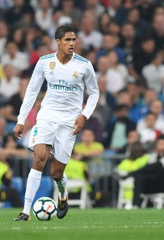 Real Madrid's defender from France Raphael Varane controls the ball during the Spanish league football match Real Madrid CF against Real Betis at the Santiago Bernabeu stadium in Madrid on September / AFP PHOTO / GABRIEL BOUYS Champions League, Fifa, Football Match, Soccer, Sporty, Portugal, 1, Spain, Argentina