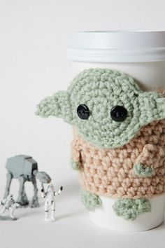 Crocheted Yoda Coffee Cozy. No pattern just pictures; might be able to figure pattern out just by looking