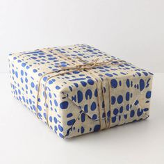 This wrapping paper is from Anthropologie, but I'm sure you could mimic a similar style with butchers paper/parchment and ink!