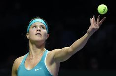 Eugenie Bouchard of Canada serves a ball to Simona Halep of Romania during the Women's Tennis Association (WTA) championships in Singapore on October 20, 2014. (ROSLAN RAHMAN/AFP/Getty Images)
