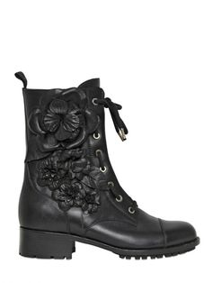Valentino Embroidered Combat Boots I bet these are pricey. Too bad- I would wear them on call.