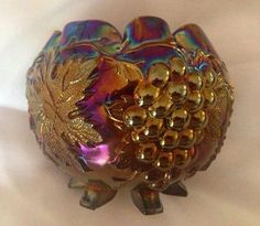 Dusty is a big fan of collectors clubs. One of the most innovative clubs out there is Iridescent Nation for young collectors of carnival glass, 1-18!  They have a good online presence and just recently awarded this Dugan Grape Delight rosebowl to a member who correctly identified it.  The only thing we can say is bravo to smart young people who have such technical ability and good taste!  Their website is -http://iridescentnation.com/