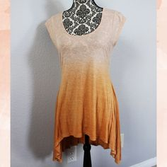 Ombré Top This cute peachy ombré top is super flattering and flowy with a high low style. Material is soft and stretchy. There are small holes in the shoulder that are barely noticeable. In great condition otherwise. Size large would fit an 8-10. Tops