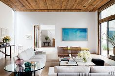 ...I love this room, nuetral with wood and color and texture on chair.  Eduardo likes...   Rosie+Huntington-Whiteley+and+Jason+Statham+in+Talks+to+Buy+Jenni+Kayne's+House—Take+the+Tour!+via+@domainehome