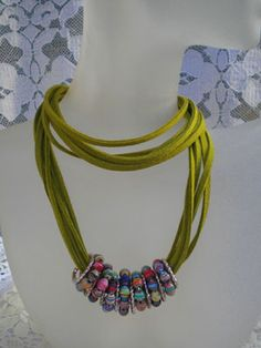 alternate paper beads and jump rings - LOTS of inspiration & tutorials for paper beads here.