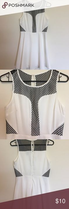 Forever 21 White dress with black mesh detail. Black mesh gives it a little bit of an edgy look!bust measures 15 inches across. Length measures about 33 inches from top of strap to bottom of skirt. Feel free to ask any questions! Forever 21 Dresses Midi