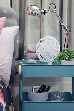 "Use the $30 RASKOG IKEA turquoise rolling utility cart as a tall nightstand.  The 3 shelves provide lots of storage, 14 x 18 x 31"".  Light is the Ikea Ranarp Work Lamp in Chrome."