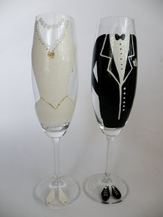 Hand painted Wedding Toasting Flutes Set of 2 Personalized Champagne glasses Groom and Bride Wedding dress and Suite. $49.00, via Etsy.