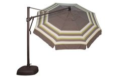 Offset patio umbrellas such as the 11' AKZ by Treasure Garden can shade your dining area, chaise lounge chairs, spa, or grill area