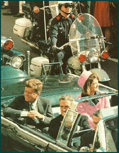 Novemeber 22, 1963   Jackie Kennedy in her pink Chanel suit and pillbox hat riding through Dallas in a mortorcade just minutes before a sniper kills President John F. Kennedy, her husband.