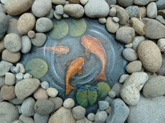 Paint a water scene including koi, lily pads, and a dragonfly on slate. Surround it with river rocks. Looks very neat!!