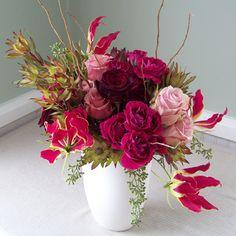 flowers: like the dark cottage (?) roses.