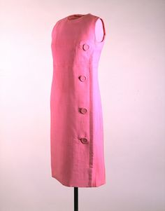 Designer: Donald Brooks (American, 1928 - 2005)  Manufacturer: Townley (American, established 1948)  Place Made: USA  Date Made: 1962  Medium: Silk Shantung  Shift dress in pink silk shantung with four large covered buttons down the side. The dress is sleeveless with an Empire waist. It was worn by First Lady Jacqueline Kennedy during a cruise of the Ganges River in Benares, India during her state visit on March 16, 1962.