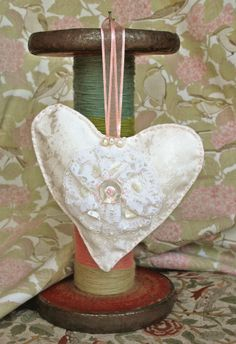 A patterned silk heart, embellished with lace and fresh water pearls and mother of pearl buttons and beads- made by my Mom.  Available to buy at www.clairecooperwalsh.com