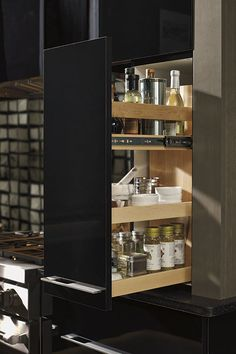 Our functional Wall Pullout Cabinet features adjustable shelving in natural maple and chrome finished side rails.