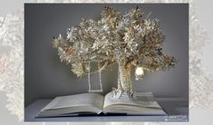 Heather Cook creates beautiful scenes in the pages of books (literally).