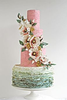 A Four-Tiered Cake with Cascading Flowers | Wedding Cake