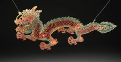 Dragon shadow puppets ascending to heaven. This dragon, portrayed by a 20th century Chinese shadow puppet, was considered to be underwater royalty. #MythicCreatures