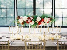 """JP: A """"T"""" shaped arrangement of romantic red, blush and white roses with gold accents and greenery."""