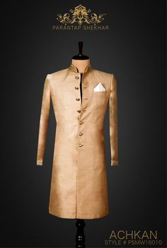 MENSWEAR: Snow White Royal Fine Yarns Hand Spun Khadi Silk Achkan, Metallic Buttons at Straight front Placket and Golden work at Sleeves Ends.  Complete Outfit: Achkan, White Pyjama Pants & Silk Pocket Square  For more info, catch us on  www.parantapshekhar.com