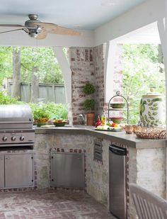 Traditional Patio with outdoor pizza oven, Outdoor kitchen and grill, Concrete counters, Exposed brick, Mini refrigerator