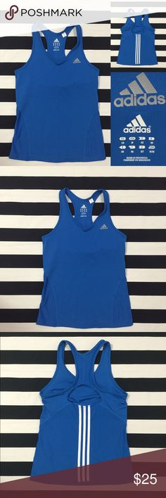 [Adidas] women's racerback tank top szM [Adidas] women's racerback tank top szM •🆕listing •great used condition •blue with white signature stripe detail on back •silver insignia (no wear/cracking) •built in sport bra liner •material 92% polyester and 8% spandex •Adidas shorts szM in photo available in separate listing •Offers welcomed using the offer feature or bundle for the best discount Adidas Tops Tank Tops